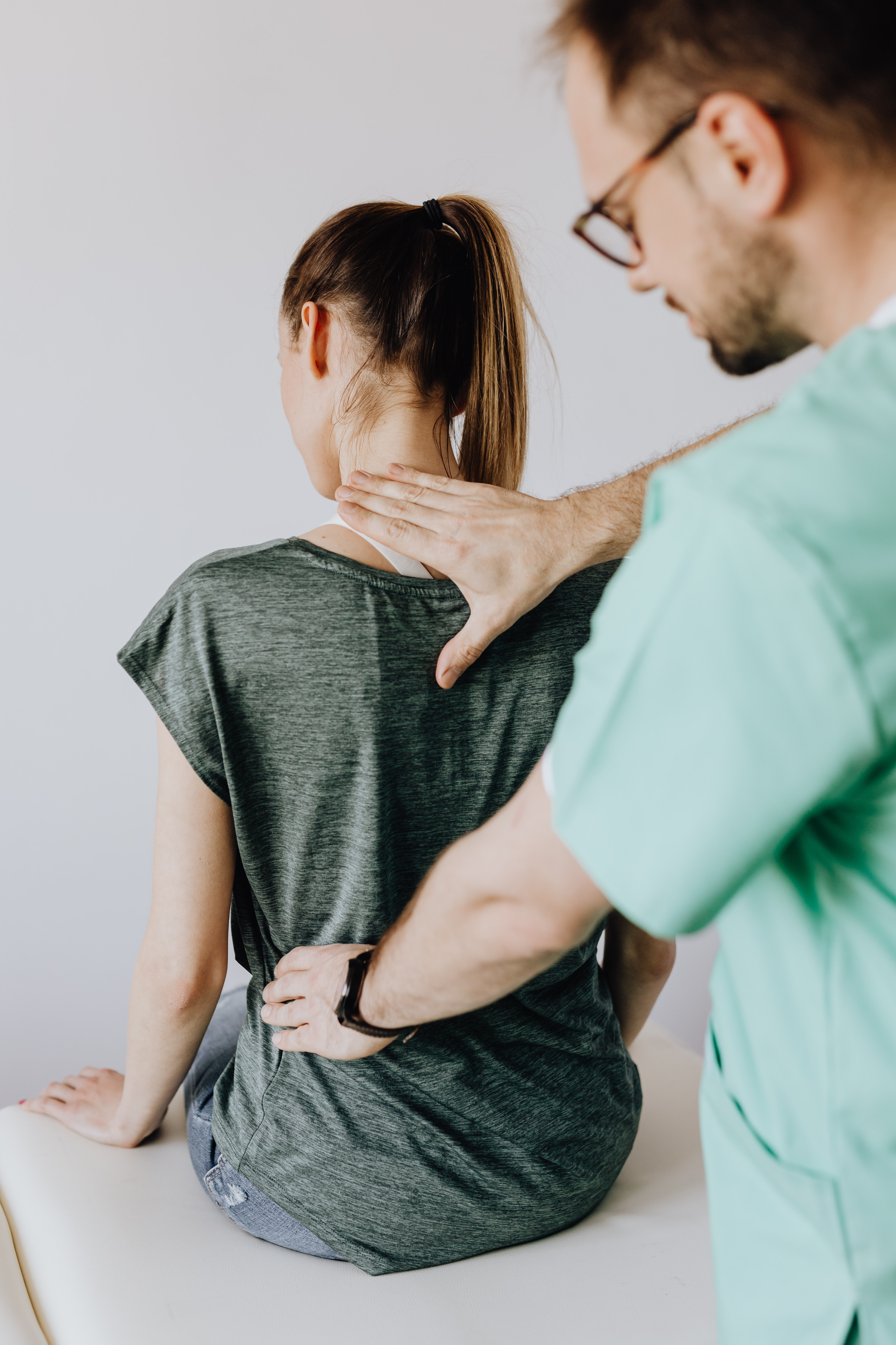 woman getting adjusted by chiropractor